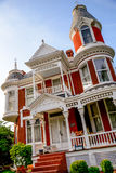 Victorian Brick Bed and Breakfast Home. Queen Anne archictecture with beautiful landscaping in Lexington, Missouri Royalty Free Stock Photography