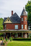Victorian Brick Bed and Breakfast Home. Queen Anne archictecture with beautiful landscaping in Lexington, Missouri Stock Photography
