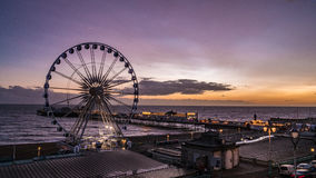The Victorian Brighton Pier and the Brighton wheel after sunset Stock Photos