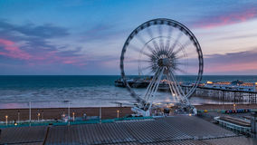 The Victorian Brighton Pier and the Brighton wheel at sunset Royalty Free Stock Photos