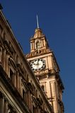 Victorian Clock Tower. Clock tower in Victorian building Melbourne against blue sky Stock Images