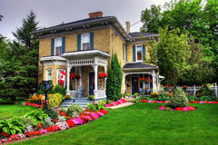 Victorian cottage. Victorian style cottage and garden in Goderich, Canada Royalty Free Stock Photo