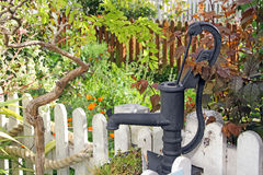 Victorian cottage garden water pump Stock Photos