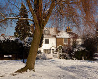 Victorian Cottages Snow Scene. Enfield War Memorial, Poppy Wreath obscured by snow Royalty Free Stock Images