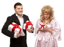 Victorian couple with gift boxes Stock Image