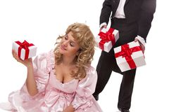 Victorian couple with gift boxes Stock Photos