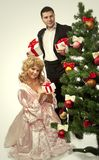 Victorian couple near a Christmas tree Royalty Free Stock Photo