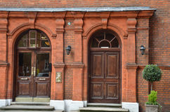 Victorian double door. Entrance with red brick royalty free stock images