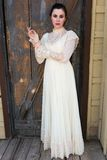 Victorian dress. Pretty brunette in a vintage Victorian dress royalty free stock image