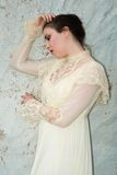 Victorian dress. Pretty brunette in a vintage Victorian dress Royalty Free Stock Photography