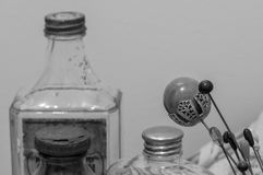 Victorian Era Lady's Accoutrements. Monochrome view of Victorian era hairpins, with equally old boudoir bottles Stock Photography