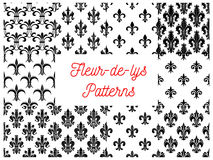 Victorian fleur-de-lis seamless patterns set. Victorian fleur-de-lis black and white seamless patterns set with stylized floral ornaments of lily flowers, buds Royalty Free Stock Images