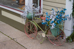 Victorian Floral. Floral decorated Victorian style bicycle outside shop Stock Image