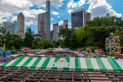Victorian Gardens in Central Park. Central Park, New York, US -- August 31, 2016. Victorian Gardens amusement park  in Central Park with city skyscrapers in the Stock Photography