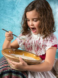 Victorian girl eating Royalty Free Stock Photography