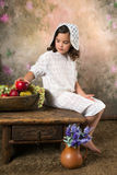 Victorian girl with fruit bowl. Classic portrait of a victorian girl and a fruit bowl Stock Images