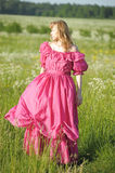 Victorian girl in vintage pink dress Royalty Free Stock Image