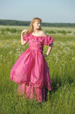 Victorian girl in vintage pink dress Stock Photos