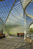 Victorian glasshouse interior. Portrait view of interior section of the restored Victorian wrought iron framed glasshouse known as Kibble Palace, Glasgow Botanic Royalty Free Stock Photo