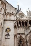 Victorian Gothic Royal Courts of Justice facade Westminster Lond. The Royal Courts of Justice the Law Courts Victorian Gothic exterior with sign and coat of arms Stock Photo