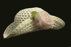 Victorian hat. A crochet Victorian doll's hat with organza ribbon flower Royalty Free Stock Photo