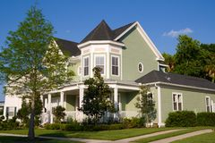 Victorian Home. Beautiful Victorian-styled home with lush landscaping royalty free stock photography