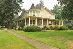 Victorian Home. Beautiful victorian home with greenery around it Royalty Free Stock Photography