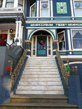 Victorian house entrance with Christmas decoration. Stairs leading to luxurious entrance in a Victorian house. Red green yellow Christmas decoration above Stock Photos