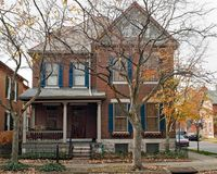 Victorian House with Red & Blue Trim in Fall Royalty Free Stock Images