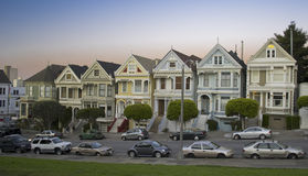 Victorian House in San Francisco. Seven Sisters in Alamo Square, San Francisco, California, taken at the end of a summer day with city skyline in the background Stock Photo