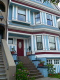 Victorian House San Francisco. Victorian house well kept and recently painted. Wrought iron rail, & nice stuccos. Typical stairs leading to main entrance Royalty Free Stock Image
