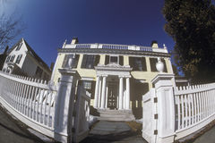 Victorian house with white picket fence through fish-eye lens, Woodstock, NY Royalty Free Stock Images