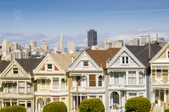 Victorian Houses. Postcard Row Victorian-style houses with San Francisco skyline in the background Royalty Free Stock Image