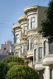 Victorian Houses San Francisco. View of Victorian houses with curved bay windows in downtown San Francisco, against blue sky. Vertical format Royalty Free Stock Images