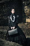 Victorian lady in black. Stock Photos
