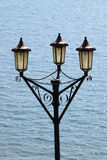 Victorian Lamps. These lamps are situated on the promenade of the Hoe, Plymouth UK, where Drake played bowls whilst waiting for the Spanish Armada to appear on Royalty Free Stock Photos