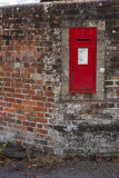 Victorian Letterbox in Garden Wall. Found in Westcott in Surrey, England.  A piece of history over 100 years old Royalty Free Stock Photos