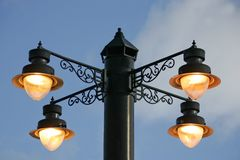 Victorian light. Victorian street lamp shining at daytime Stock Images