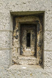 Victorian loophole in stone wall. Stock Images