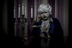 Victorian, man dressed in rococo style, concept of wealth and po Royalty Free Stock Image