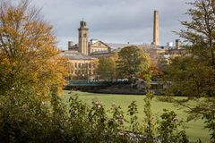 Victorian model village of Saltaire glimpsed through the trees stock photo