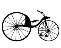 Victorian old retro bicycle  silhouette isolated on white backgr Stock Images