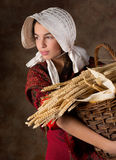 Victorian peasant girl. Reenactment image of a victorian peasant girl holding a basket Royalty Free Stock Photo