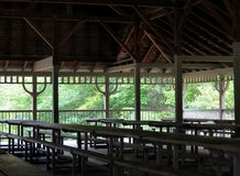 Victorian Picnic Pavilion. Pavilion seen from the inside with the picnic tables lined up for a family reunion stock images