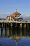 Victorian pier building. View of the Victorian building on Dunoon Pier, Argyll and Bute, Scotland, showing reflection of pier and building on water Royalty Free Stock Photos