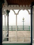 Victorian Pier Window, view to sea. Victorian Pier Window - mysterious, misty.  Some reflections in and marks on the glass of the window Royalty Free Stock Photos