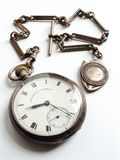 Victorian pocket watch and chain. Detail shot of an old Victorian fob watch and chain shot against a white background royalty free stock photos