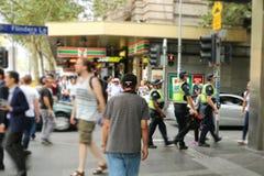 Victorian Police members on foot patrol in Flinders Lane, Melbourne. MELBOURNE, AUSTRALIA - March 15, 2017: Victorian Police members on foot patrol in Flinders Stock Images