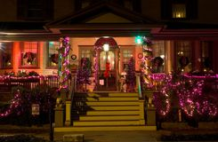 Victorian Porch at Christmas. The porch of an old Victorian Era house decorated with pink lights and decorations for the Christmas holidays Royalty Free Stock Images