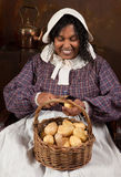 Victorian potato peeling Royalty Free Stock Images